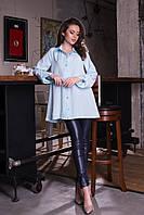 Женская удлиненная рубашка-туника на пуговицах с длинным рукавом.