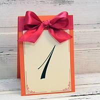 Номер на свадебный стол с бордовой лентой на оранжевой основе