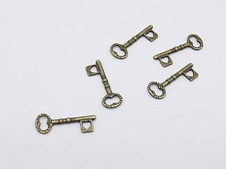 Металеві накладки. Ключик. Колір антична бронза. 12х34мм