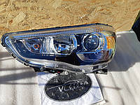 Фара ліва Mitsubishi 8301C215 Outlander 12-15 США вживана, фото 1