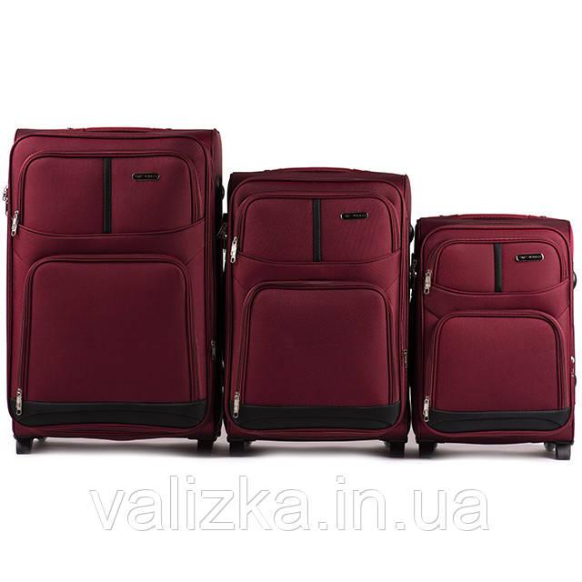 Комплект текстильных чемоданов для ручной клади, средний и большой на 2х колесах Wings 206 бордового цвета.