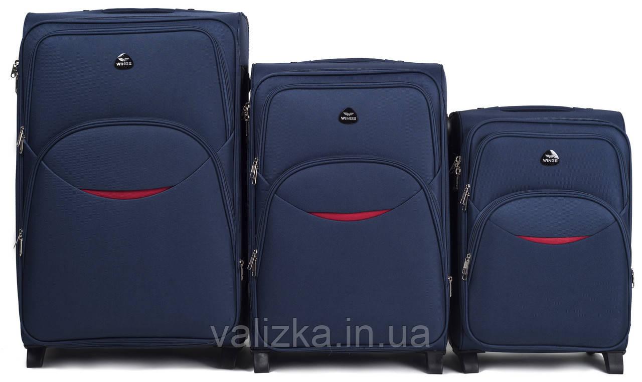 Комплект текстильных чемоданов для ручной клади, средний и большой на 2-х колесах Wings 1708 синего цвета.