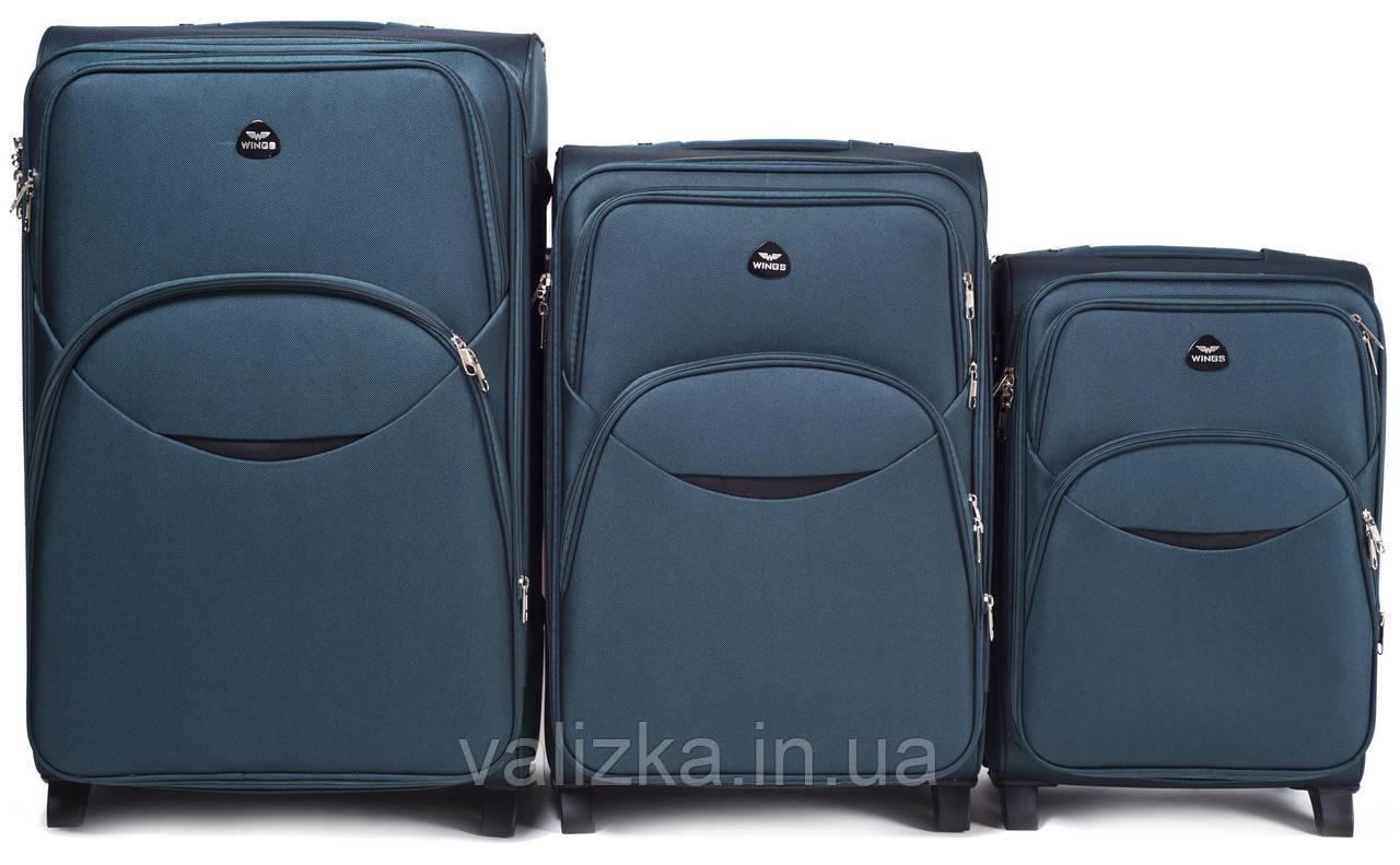 Комплект текстильних валіз для ручної поклажі, середній і великий на 2-х колесах Wings 1708 темно-зелений.