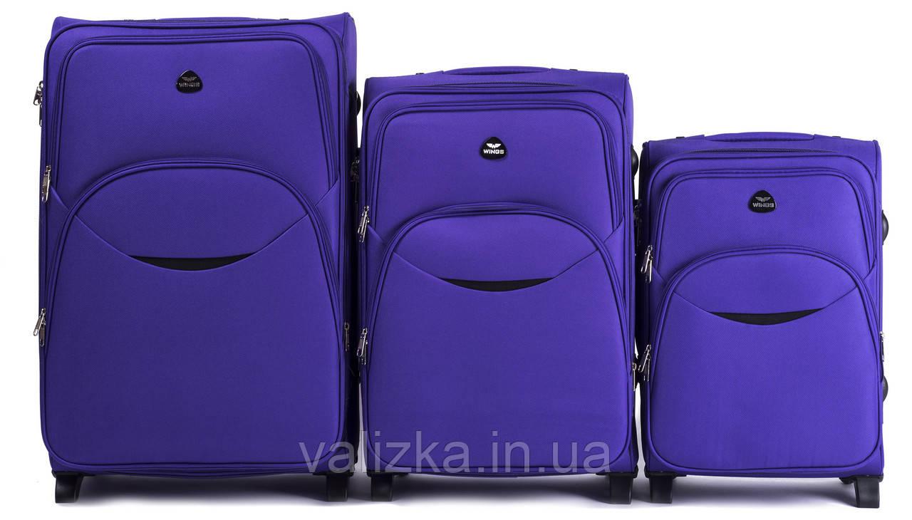 Комплект текстильных чемоданов для ручной клади, средний и большой на 2-х колесах Wings 1708 фиолетовый.