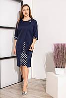Оригінальне синє плаття декороване в горошок з прикрашеною горловиною