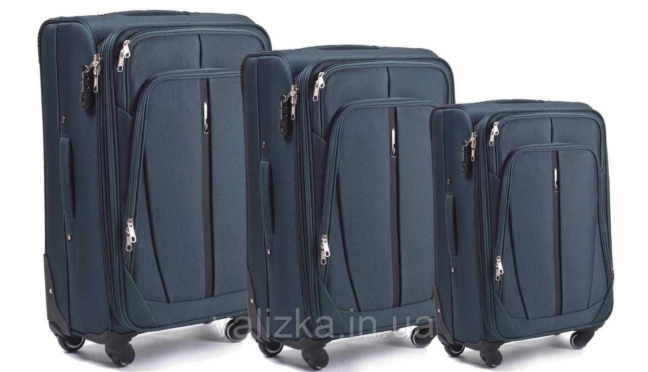 Комплект текстильних валіз для ручної поклажі, середній і великий на 4-х колесах Wings 1706 темно-зелений.