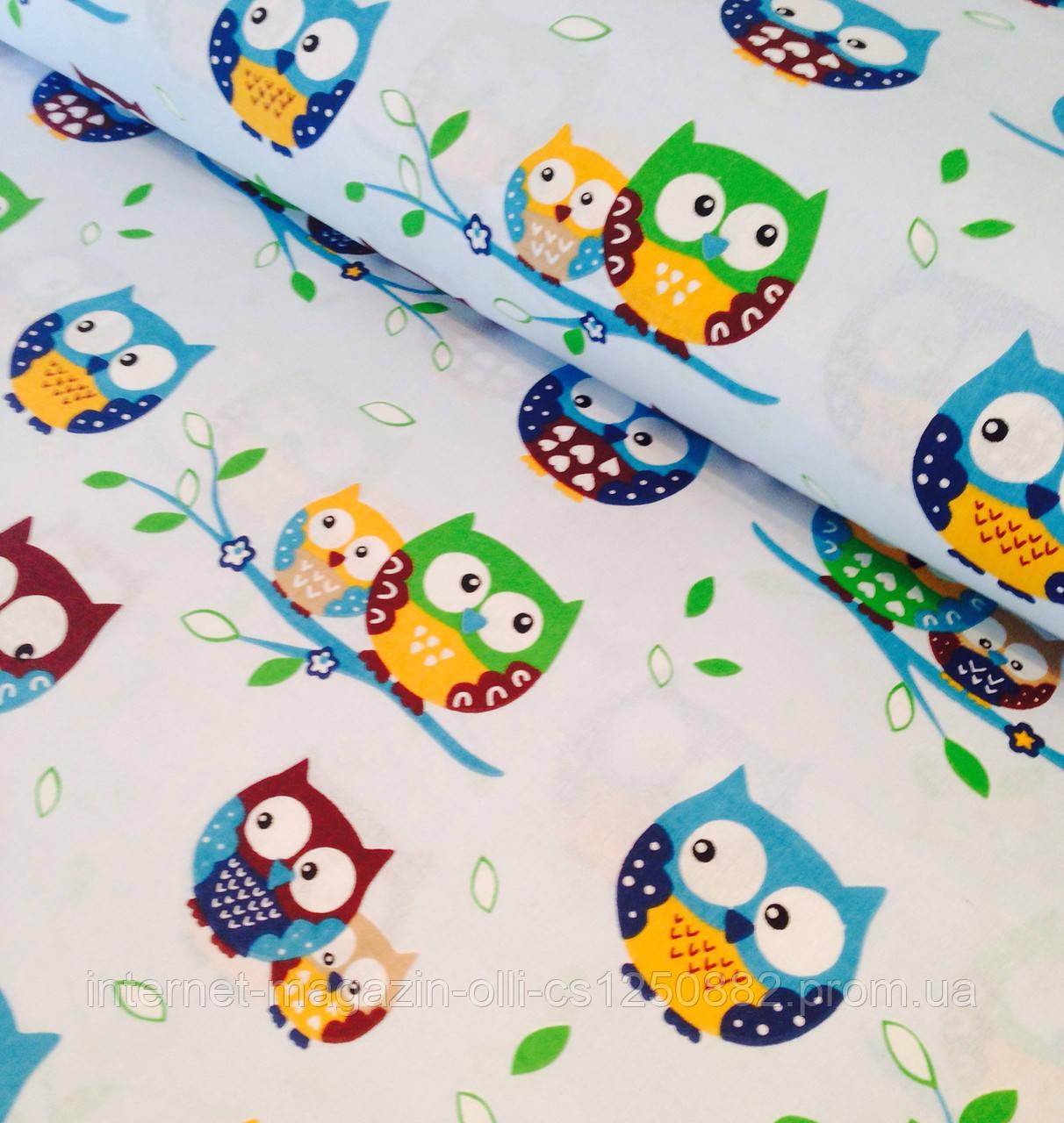 Хлопковая ткань польская совы цветные на голубом