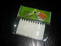 Скребок двухсторонний зубчатый