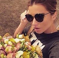 Солнцезащитные очки Dior Homme с салатовыми вставками.