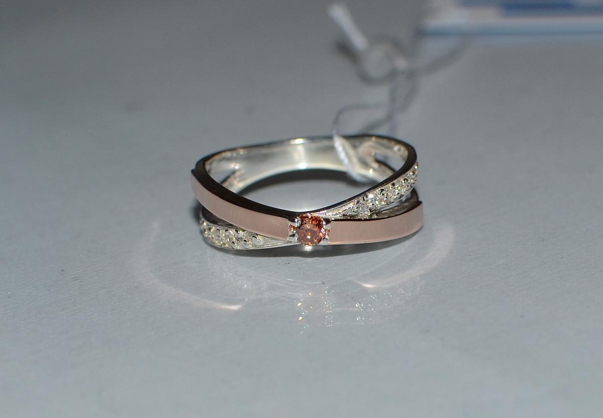 Серебряное кольцо со вставками из золота 057к 15