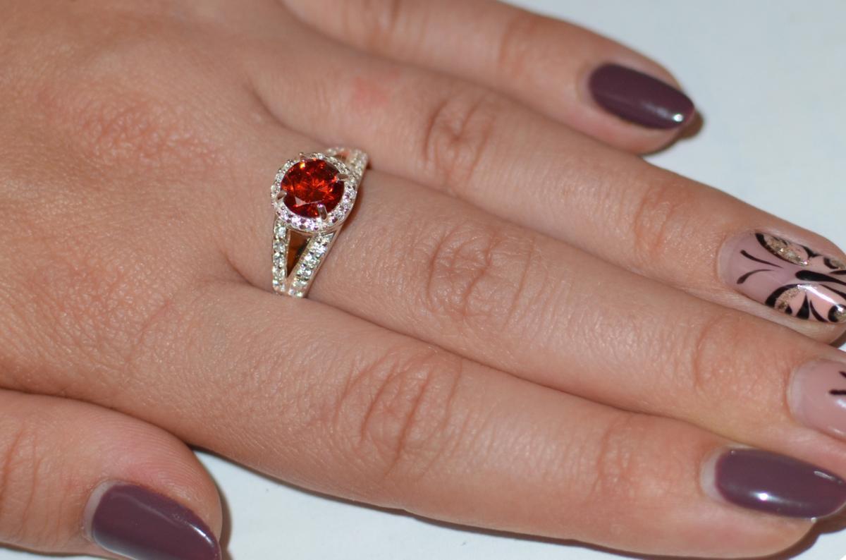 Серебряное кольцо с золотыми накладками 058к 15 Рубин