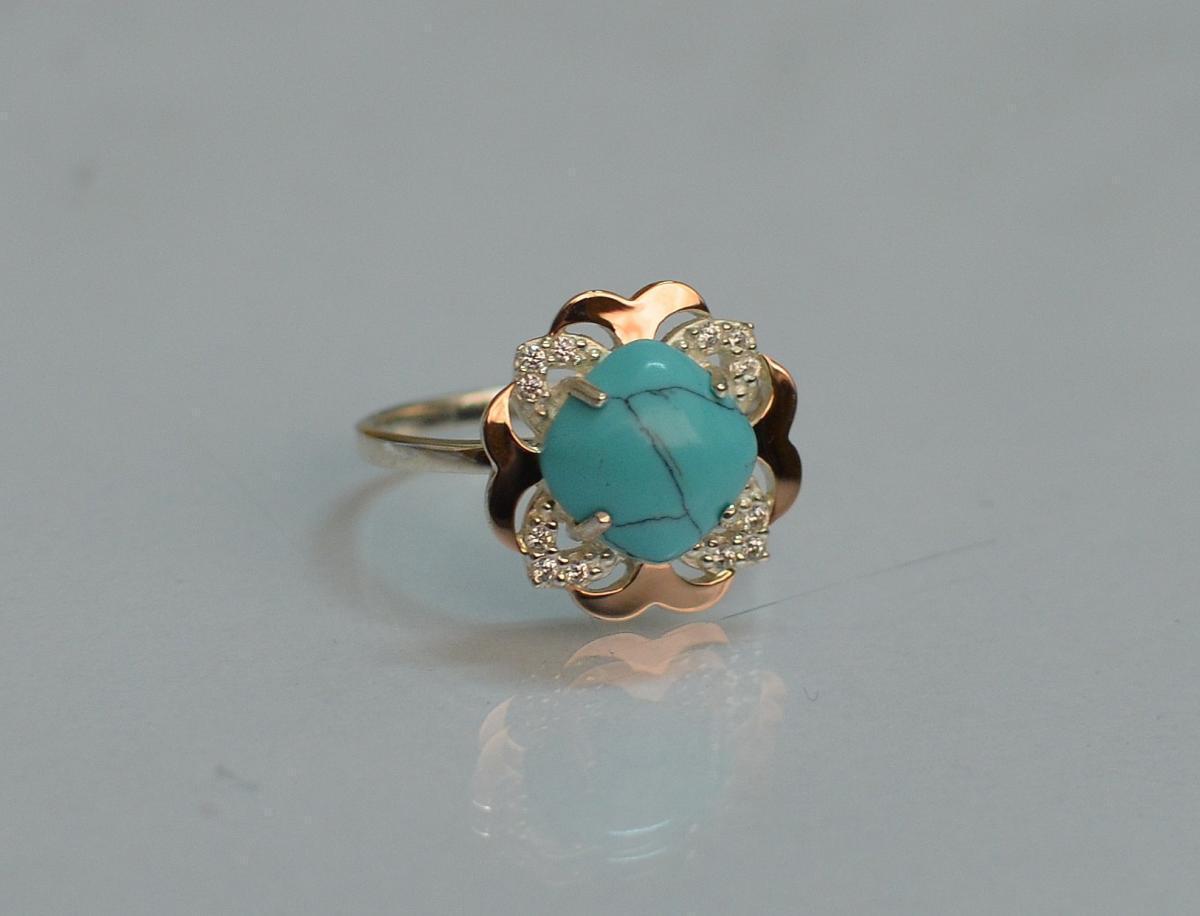 Серебряное кольцо с золотыми вставками 165к 15