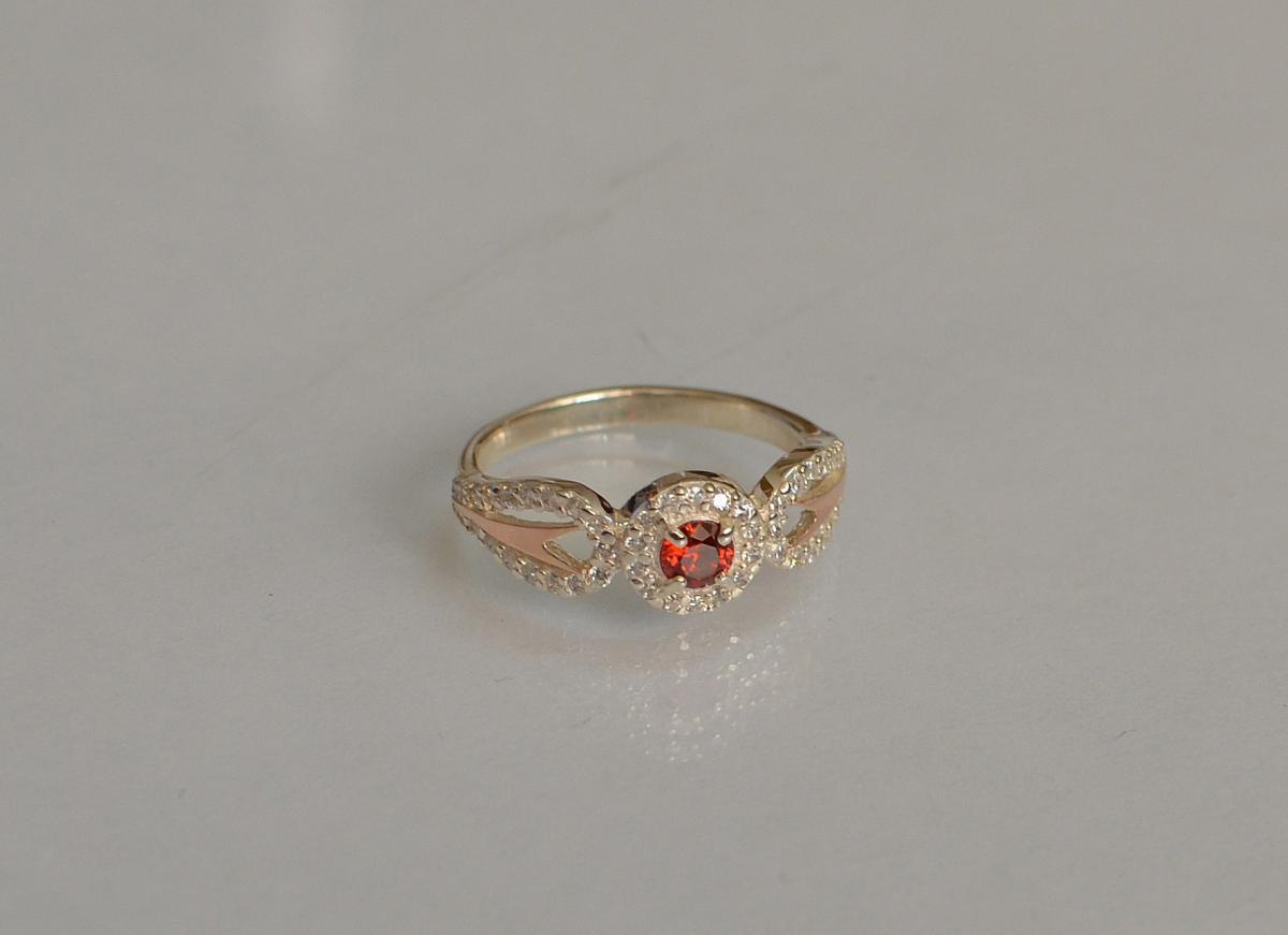 Серебряное кольцо с золотыми пластинами 135к 15 Гранат
