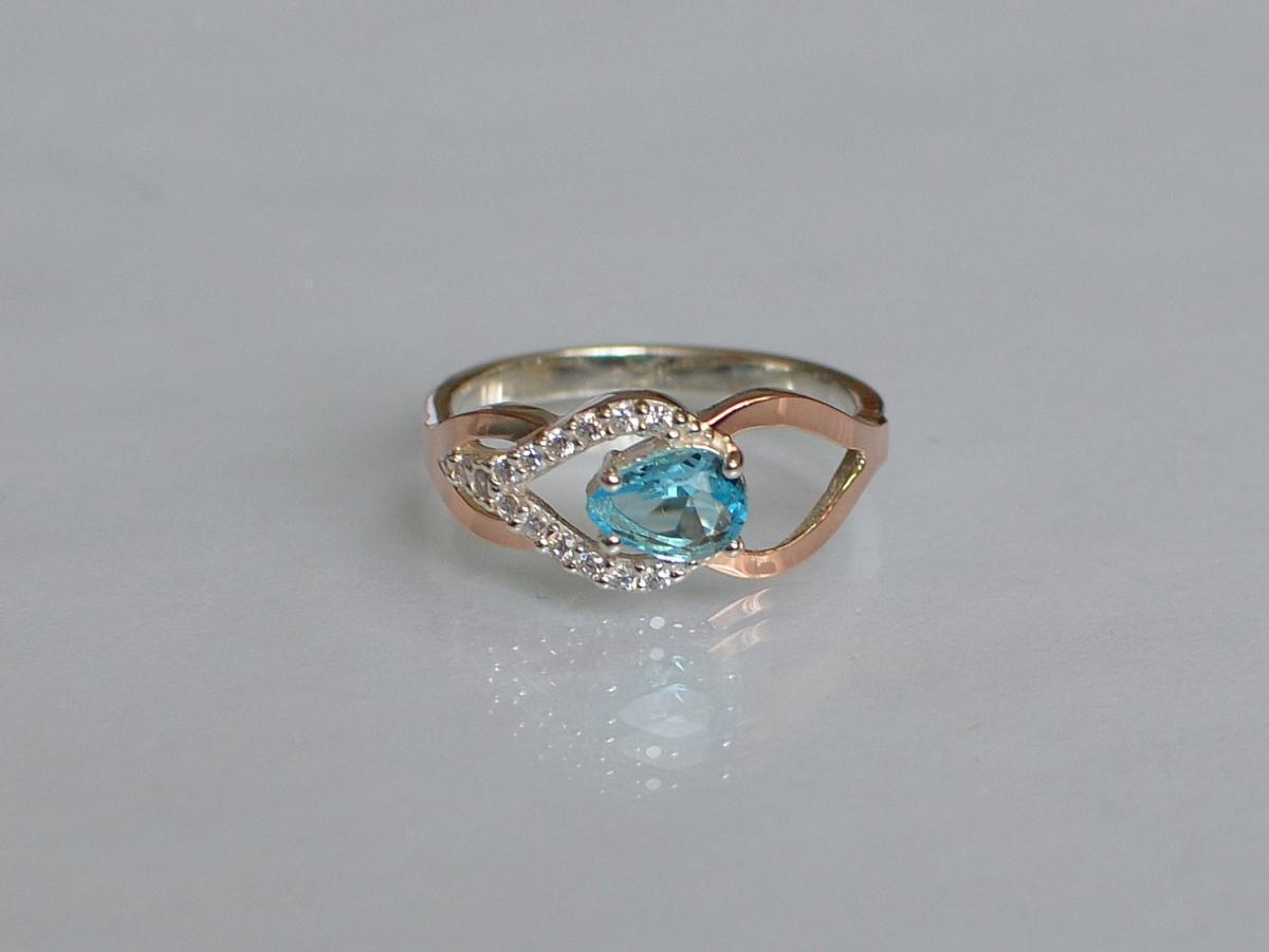 Серебряное кольцо с золотыми вставками 132к 15