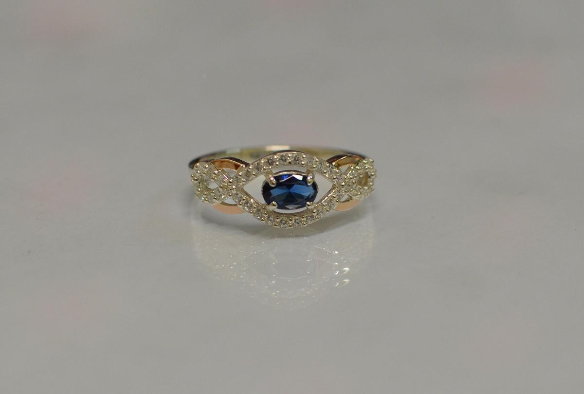 Серебряное кольцо с золотыми накладками 125к 15