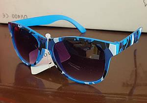 Солнцезащитные детские очки в камуфлированной оправе