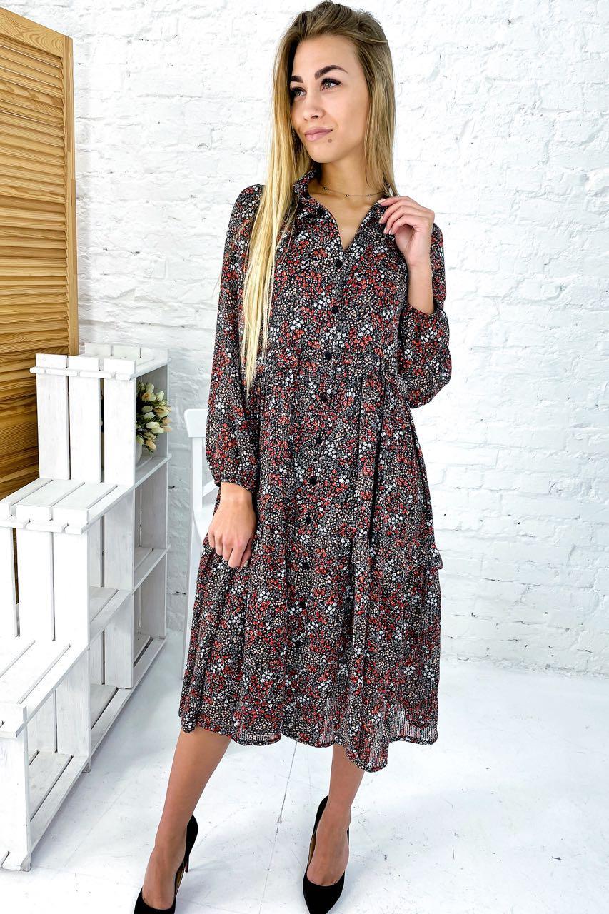 Прекрасное нарядное платье из высококачественной ткани в полоску с мелким флористическим принтом.
