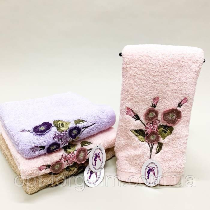 Полотенца фиалки объемные