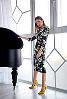 Элегантное черное платье с отрезной талией и цветами