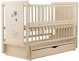 """Дитяче ліжечко Дубик-М """"Ведмедик"""" слонова кістка з відк.боковинкою на маятнику з шухлядою"""