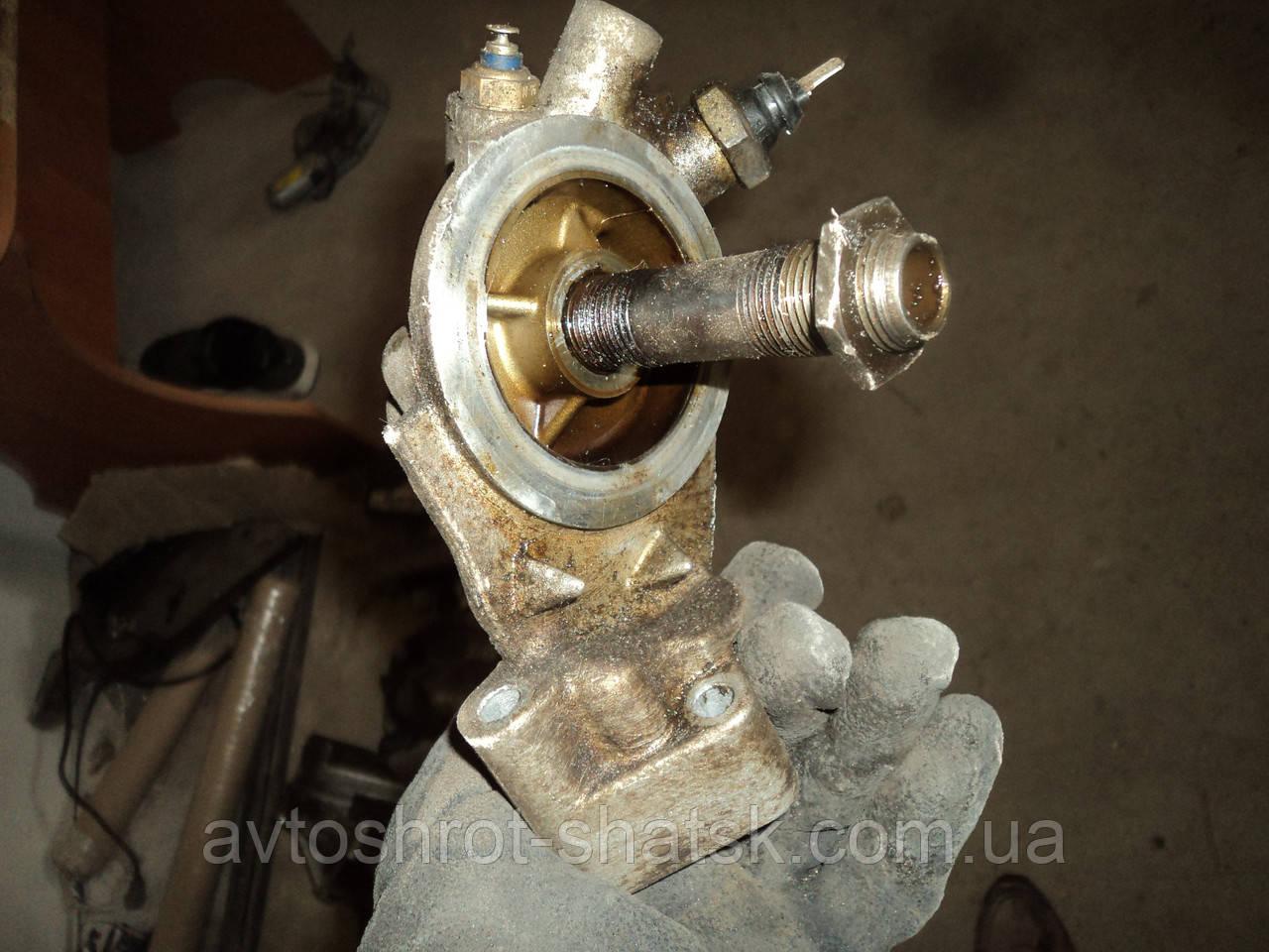 Б/К кронштейн крыпления  масляного фильтра аудии а6 с4 1.8 бензин