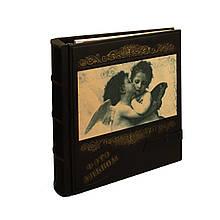 """Фотоальбом в кожаном переплете украшен фотопечатью на коже с магнитными листами """"Ангелочки"""""""