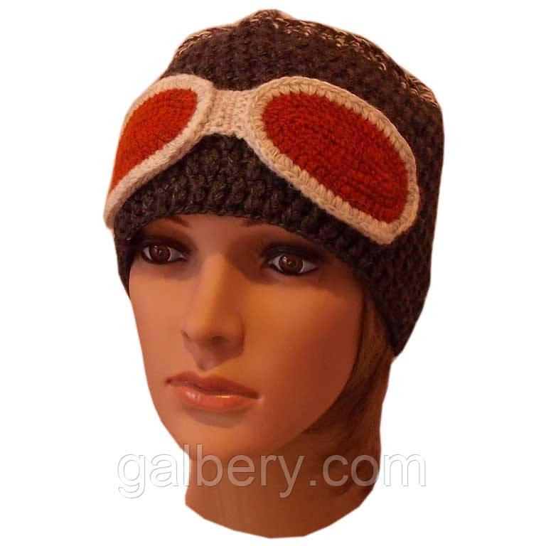 """Женская вязаная шапка объемной ручной вязки комбинированной расцветки, декорированая """"очками"""""""