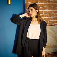 Черный модный пиджак свободного силуэта