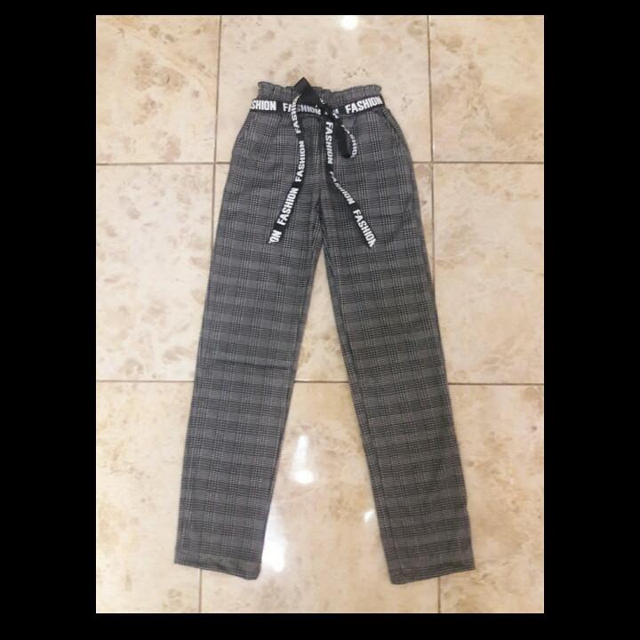 Модні штани в клітку для дівчинки