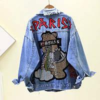 Объемная джинсовая куртка с ярким крупным принтом