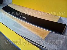 Накладка на бампер с загибом для Renault Logan с 2012 г. (Nataniko Carbon)