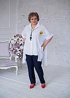 Туніка-сорочка білого кольору з аплікаціями по спинці