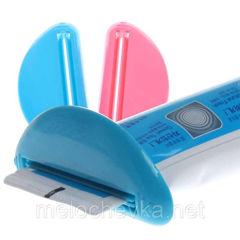 Выдавливатель-зажим для зубных паст и крема