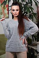 Женский свитер с длинными рукавами и круглой горловиной. Размер универсальный. Серый