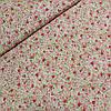 Поплін з дрібними рожевими і червоними трояндами на молочному тлі, ширина 150 см