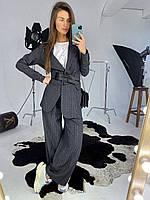 Женский стильный брючный костюм в клутку (пиджак и брюки клеш)