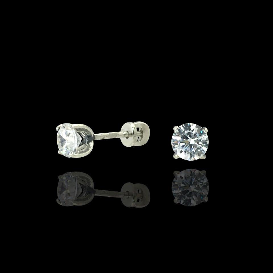 Изящные серебряные серьги-пусеты с камушком