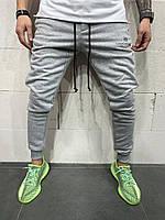 Мужские спортивные штаны серого цвета с манжетом