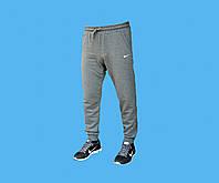 Брюки спортивные Nike трикотажные, без начёса внутри.Манжет внизу.Зауженные.Серые.2157