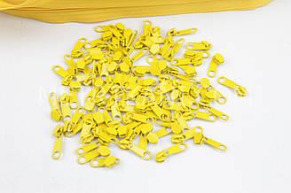 Бегунок металлический желто -оранжевого цвета для рулонной молнии № БМ-152-Т3