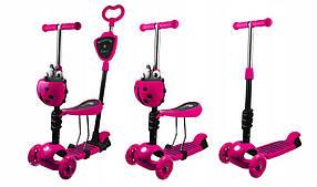 Трехколесный самокат Божья коровка 5в1.  С сиденьем и корзинкой. Светящиеся колеса Best Scooter Розовый