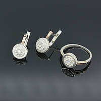 Комплект срібних прикрас Дама з цирконами різного розміру сережки та каблучка