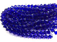 Бусины на нитке Стекло биконус 10мм цвет синий (~32 бусины на нитке)