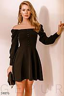 Короткое расклешенное платье-мини с декольте и объемным рукавом черное
