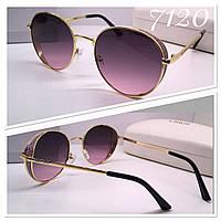 Солнцезащитные очки кругляши розовые