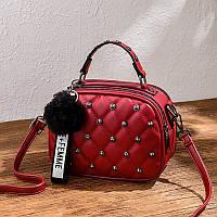 Стильная , качественная женская сумка . Красного цвета.