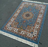 Купить в Одессе подлинные ковры из Ирана голубого цвета со светлой каймой