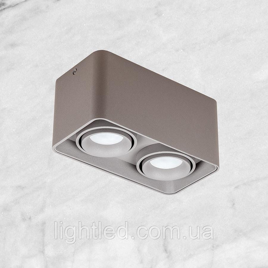 Серый светильник с направлением света