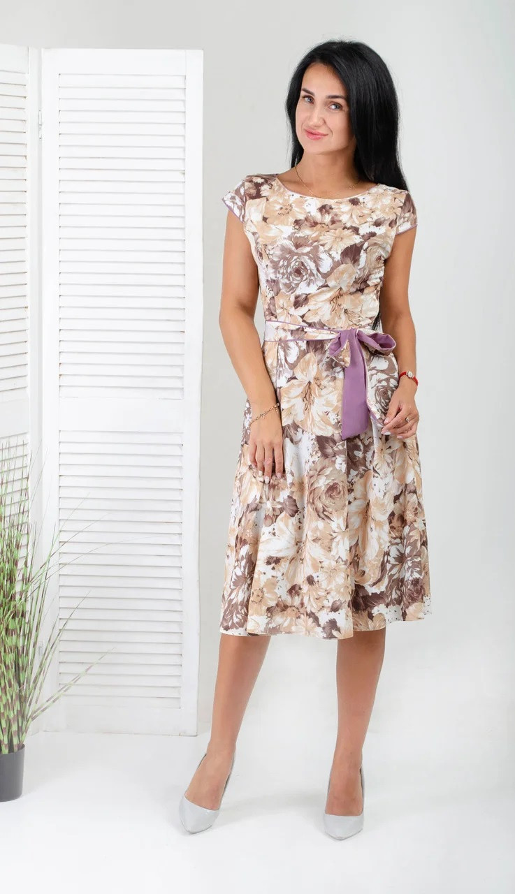 Красиве літнє плаття з квітами і горох