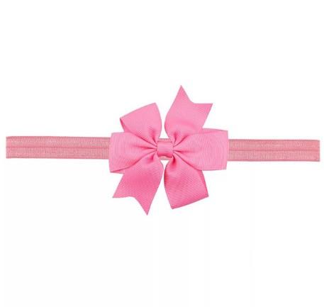 Дитяча пов'язка рожевого кольору - на резинці, окружність від 30см до 48см, бант 9см